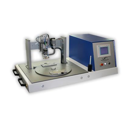B�gell�tsystem mit Drehteller in Desktop - Ausf�hrung mit einem Drehteller Durchmesser bis zu 500mm.  Auf dem Drehteller der Anlage befinden Befestigungsm�glichkeiten f�r bis zu vier Bauteilaufnahmen bzw. Werkst�cktr�ger.